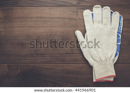 working gloves on the brown wooden background - stock photo