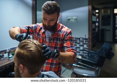 Working hairdresser in barber shop