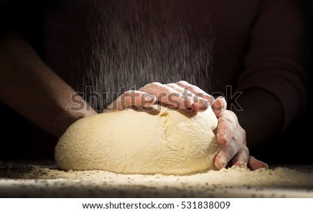 Working hands kneading bread dough