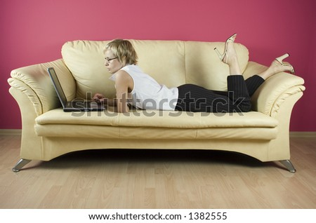 Working home on the sofa - stock photo