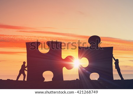 Working in collaboration for success - stock photo