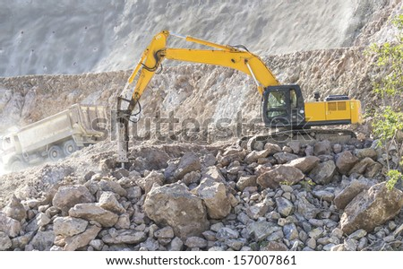 working in heavy construction excavator at work - stock photo