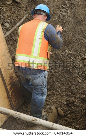 working in the  excavation hole to repair a 12 inch water main failure on Harvard Ave in Roseburg OR