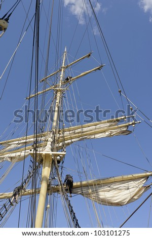 Working in the rigging of a brig - stock photo