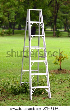 Working ladder in the park - stock photo