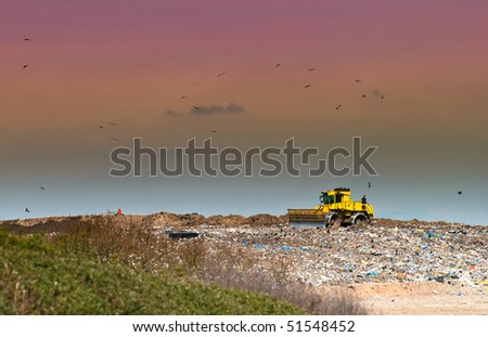 Working landfill site in the countryside - stock photo