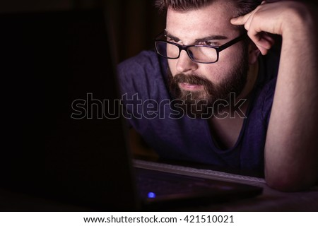 Working late night and thinking about work - stock photo