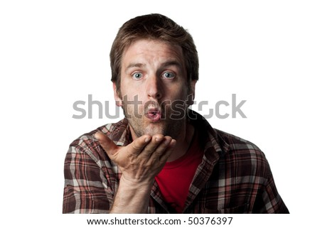 Working man blowing a kiss to the camera - stock photo