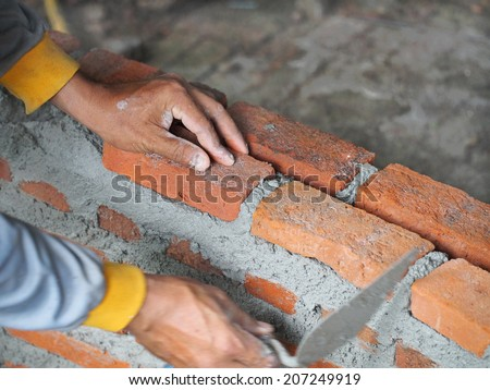 Working man build the block and wall