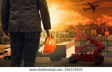 working man in container dock and air ,land transport ,import export logistic cargo freight and shipping commercial service industry - stock photo