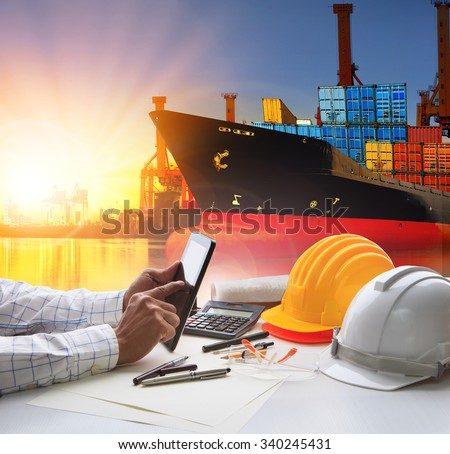 working man in shipping and cargo port  - stock photo