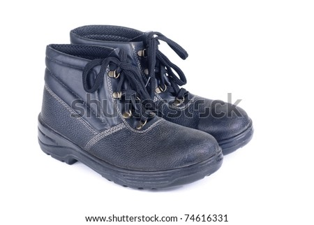 Working man's boots black isolated on a white - stock photo