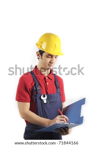 working mechanic checking and verifying - stock photo