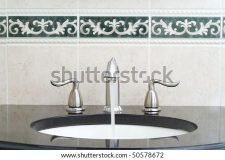 Working mixer tap - stock photo