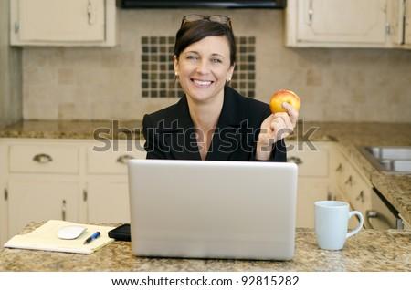 Working mom with makeshift office set up in the kitchen