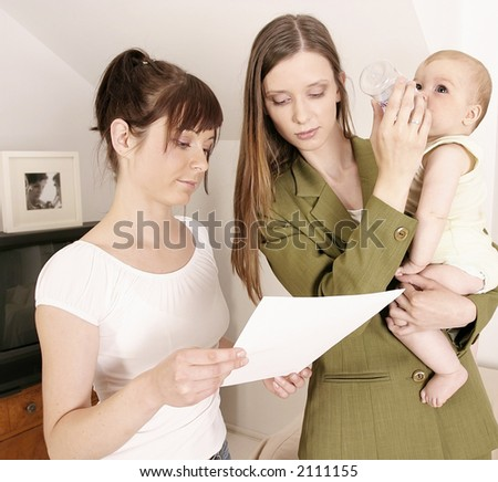 working mother leaving a baby at home with a babysitter - stock photo