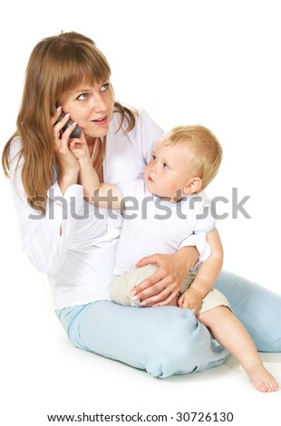 Working mother on phone while holding her baby