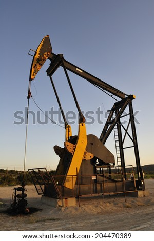 Working oil pump in deserted district  - stock photo