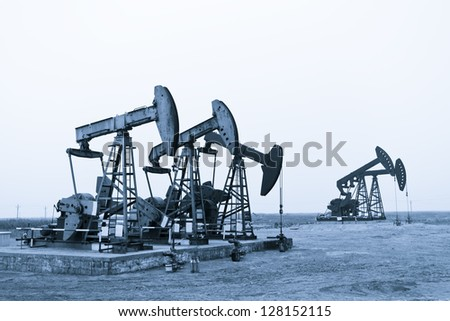 Working oil pumps at prairie - stock photo