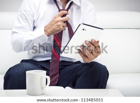 Working on a digital tablet - stock photo