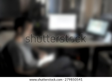 Working on a digital tablet blurred - stock photo