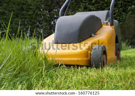 working on a lawn lawnmowers cut