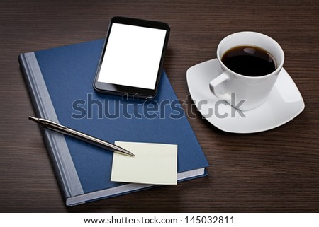 Working on a wooden table - stock photo