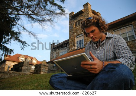 working on laptop outside - stock photo