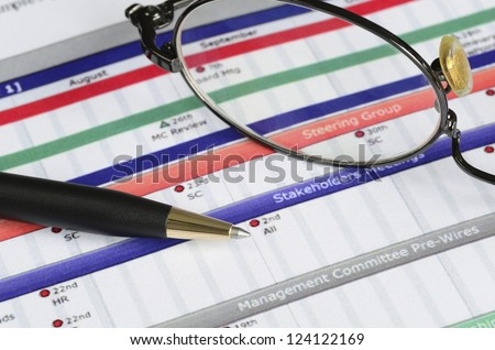 Working on the project plan concept of workflow and timeline - stock photo