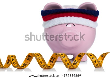 Working on your savings and measuring up - stock photo