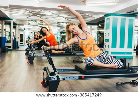 Working out on reformer beds