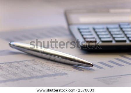 Working over charts - stock photo