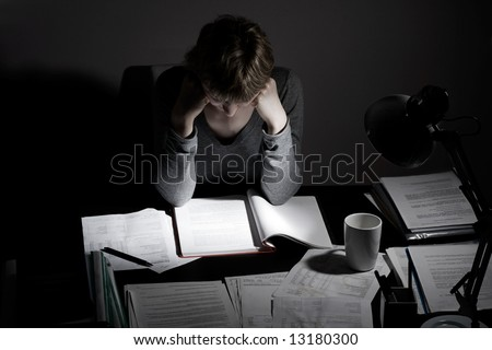 working overhours or preparing to exam, concept, low key - stock photo