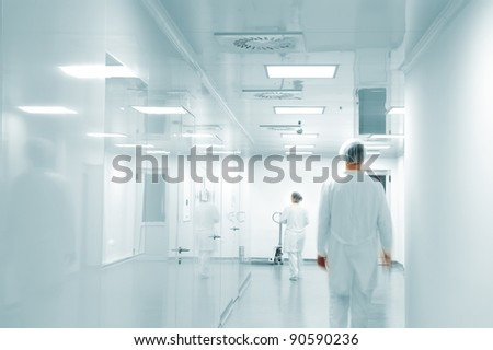 Working people with white uniforms in modern  factory environment - stock photo