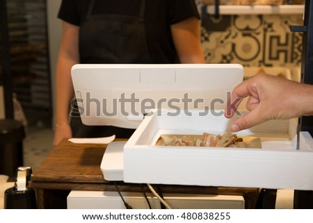 Working place at bakery, man hands picking piece of bread