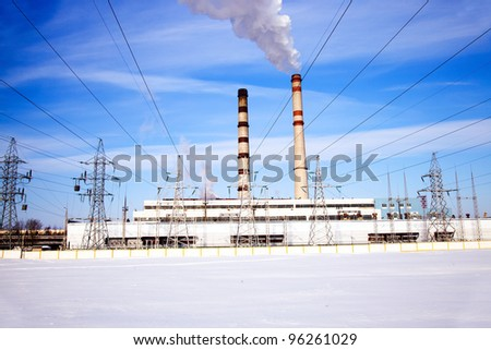 Working power station in a winter season - stock photo