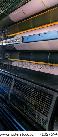 Working process of printing circulation of news newspaper. Tape of conveyor with newspaper running in process. Work of modern printing equipment when printing printed products