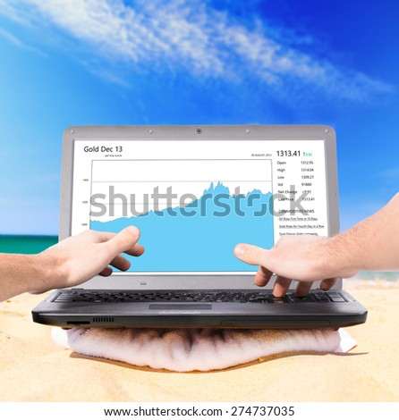 working remotely using laptop on beach - stock photo