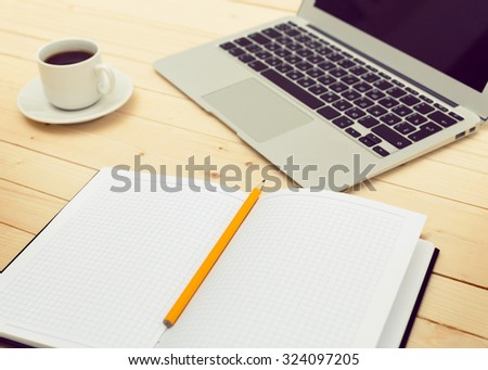 Working space. Laptop, notepad on wooden desk