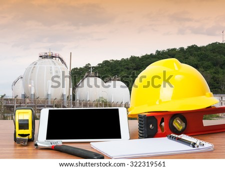 Working table engineer with tablet and tools in oil refinery industry business plant - stock photo