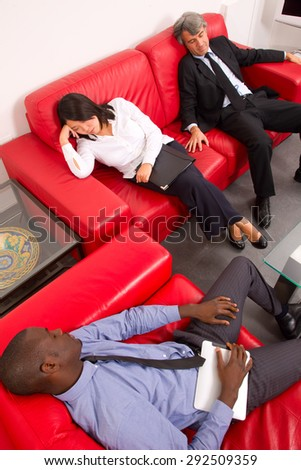 working team sleeping on the sofa - stock photo
