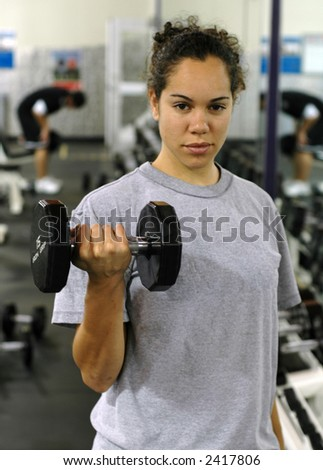 Working the biceps. - stock photo