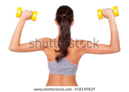 Working those biceps. Shot of a beautiful young woman exercising with dumbbells against white isolated background. - stock photo