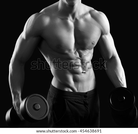 Working those muscles. Cropped black and white shot of a ripped muscled man lifting weights shirtless - stock photo