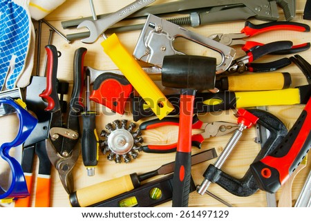 Working tools. Many working tools on a wooden background. - stock photo