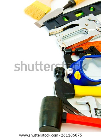 Working tools. Many working tools - stapler, pliers and others on white background. - stock photo