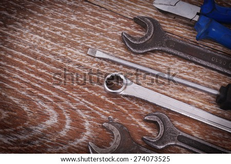 Working tools on a wooden board - stock photo