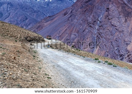 working truck in mountain closeup - stock photo