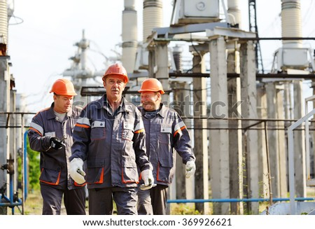 Working with a tool in the hands against the background of power plant - stock photo