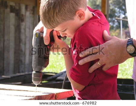 Working with Dad - stock photo